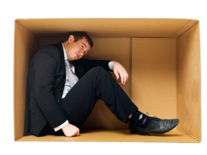 Businessman in a tight cardboard