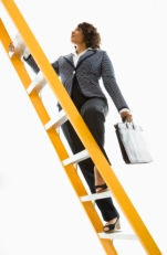 Businesswoman climbing ladder.